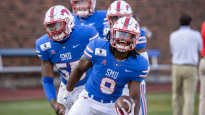 DALLAS, TX - OCTOBER 03: SMU Mustangs linebacker Shaine Hailey (#9) and teammates celebrate a fumble recovery that ended the game during the college football game between the SMU Mustangs and Memphis Tigers on October 3, 2020, at Gerald J. Ford Stadium in Dallas, TX.  (Photo by Matthew Visinsky/Icon Sportswire via Getty Images)