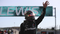 Mercedes driver Lewis Hamilton of Britain waves after clocking the fastest time during qualification for the Formula One Portuguese Grand Prix at the Algarve International Circuit in Portimao, Portugal, Saturday, Oct. 24, 2020. The Formula One Portuguese Grand Prix will take place on Sunday. (Jose Sena Goulao, Pool via AP)