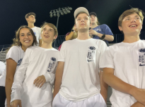 Bella Ferreira, Ryan Miller, Patrick McHale and Dean Miller Jr., all sophomores, watch the Penn State vs. Pitt Whiteout home soccer game. They said they enjoyed being able to cheer on the Nittany Lions with other students again without having to wear a mask. Unfortunately, the Nittany Lions lost 1-0.