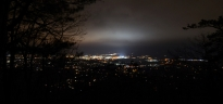 Low clouds in the night sky over State College and University Park glow in this view from atop Mt. Nittany. As Joe Paterno's body lay in state at the Pasquerilla Spiritual Center the stadium lights were left on in memory of the former head football coach, who passed away Sunday morning due to lung cancer complications.