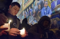 Dylan Bressler, a junior at Penn State, joins a candlelight vigil marking the one-year anniversary of the death of former Penn State head football coach Joe Paterno. Several hundred people attended the event that was held on Heister Street in State College.