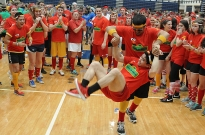 Members of the red team at the THON color wars form a dance circle Wednesday night in Rec Hall.