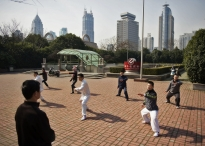 Men practice Tai Chi in People's Park in the heart of Shanghai, China.