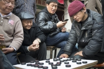 With a retirement age of 60 for most men, it's quite common to see groups of men gathering on ta sidewalk or in a park for a game of cards or checkers.
