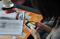 Tracy Teng, a 26-year-old public relations specialist who lives in Shanghai, peruses a Chinese social media platform smartphone in Shanghai coffee shop. Teng works at Citigate Dewe Rogerson, an international financial communications consultancy in China, where she focuses on social media marketing.