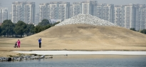 A golfer follows through with his swing at the Tomson Golf Club in the shadow of the club's version of Mount Fuji in Pudong, Shanghai on March 6, 2013. David Lee, who works as a consultant for the club, said membership fees for the club cost an initial payment of nearly $200,000 and an additional $100 each month. Tomson has played host to various professional tournaments, including the BMW Asian Open from 2005-2008.