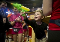 Dante Roth, 4, of Harrisburg, squirts innocent bystanders with his water gun late Friday night in the Bryce Jordan Center.  Dante came to THON with his uncle, Aidan Roth, who is a 17-year-old Four Diamonds child.