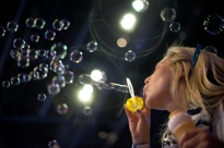 Independent Thon dancer Emmalee Bierly blows bubbles on the floor early Saturday morning.