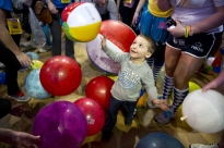 Daniel Testa, 3, a Four Diamonds child from Lancaster, plays with his family during THON on Saturday night.