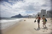 A couple strolls down Ipanema Beach. With temperatures in the 80s -- considered cool at this time of year -- the beaches were relatively empty.