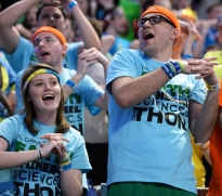 Students dance in the stands at THON on Friday night.