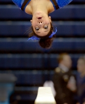 Audrey Harrison, from the University of Kentucky, performs her beam routine at the NCAA Regional Gymnastics Championships at Rec Hall at Penn State.