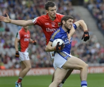 Aidan O'Mahony, (12) in red, of County Mayo reaches for the ball advanced by County Kerry's Jason Doherty, Aug. 24, 2014.
