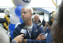 Penn State coach James Franklin speaks with the media after arriving at Dublin Airport on Wednesday morning for the Croke Park Classic, Aug. 27, 2014.