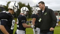 Cedar Cliff alum Kyle Brady, former Penn State and NFL tight end, shakes hands with Cedar Cliff players after the coin toss of the Penn Manor and Cedar Cliff football game in Dublin, Ireland Friday, Aug. 29, 2014.