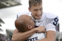 Penn State head coach James Franklin, left, lifts kicker Sam Ficken into the air after Ficken kicked a 36-yard field goal to defeat University of Central Florida, 26-24, as the clock expired in the Croke Park Classic Saturday, Aug. 30, 2014 in Dublin, Ireland.