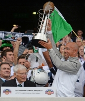 Dan Rooney, left, former United States Ambassador to Ireland and chairman of the Pittsburgh Steelers, watches as coach James Franklin hoists the Dan Rooney Trophy after Penn State defeated Central Florida, 26-24, in the Croke Park Classic in Dublin, Ireland, on Saturday, Aug. 30, 2014.