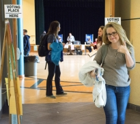 Liz McShane, a junior majoring in agricultural business, flashes a thumbs up after voting on Election Day in Heritage Hall in the HUB-Robeson Center.