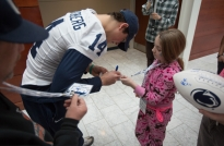 Penn State quarterback Christian Hackenberg signs an autograph for Four Diamonds child Kara Hogan.