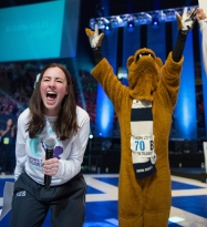 Megan Renaut, the THON 2015 director, from Spring Grove, Pa., reacts to the announcement that THON 2015 raised $13.02 million. The Nittany Lion mascot, who danced the entire 46-hour, no-sitting, no-sleeping event, joins in the celebration on stage at the Bryce Jordan Center at Penn State.