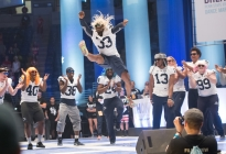 Josh McPherson (33) leaps during Penn State football's THON Pep Rally performance.