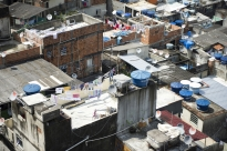 Rooftops as seen from a balcony in favela Rocinha in Rio de Janeiro, Brazil. Rocinhia is the largest favela in the city. The cisterns provide a source of running water.