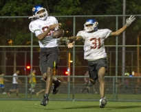 Loan Felisardo (89) and teammate Samuel Nascimento (31) run a wide-receiver drill during a practice in Flamengo, Rio de Janeiro, Brazil late one Wednesdy night.