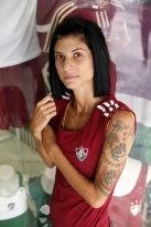 Juliana Brandão poses for a portrait outside Só Tricolor, a Fluminense Football Club shop, in Rio de Janeiro, Brazil, Monday March 5, 2012. Brandão, a store clerk at Só Tricolor, has over a dozen Fluminense related tattoos on her body. (Jill Knight/Penn State University/MCT)