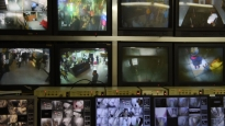 Security cameras cover 70 percent of the public areas in the Chungking Mansions building complex.The images on the screens provide a glimpse into the diversity of cultures housed in the mansions' five 17-story towers